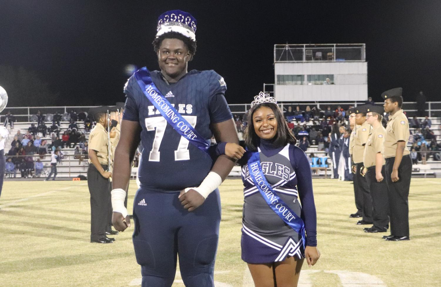 Seniors Tyler McDuffie and Brianna Simpson pose for a picture after being crowned king and queen of the 2019 Homecoming Court on Oct. 18. The halftime honor was McDuffie's first highlight of the night; his second was helping his varsity team mates beat the Comets 62-27.