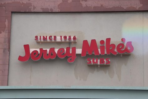 The new red Jersey Mike's sign hangs above the entrance door of the restaurant, signifying the grand opening Nov. 6. The sandwich shop can be found at Holt Garrison Parkway Suite across from Old Navy and Marshalls, between AT&T and Wood's Menswear.