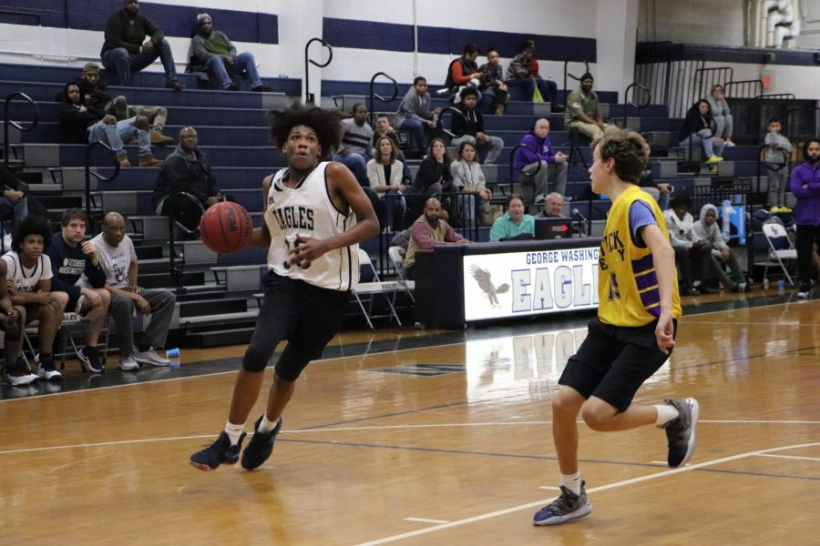 Eyeing+the+goal+above+him%2C+Sophomore+Xavier+Walters+gains+possession+of+the+ball+as+his+opponent+uses+his+defense+skills+to+stop+him.+For+their+first+scrimmage%2C+the+junior+varsity+and+varsity+basketball+teams+battled+the+Patrick+Henry+High+School+Patriots+on+Nov.+21.+%E2%80%9CI+feel+like+we+are+going+to+do+a+lot+of+great+things+this+season%2C%E2%80%9D+Walters+said.