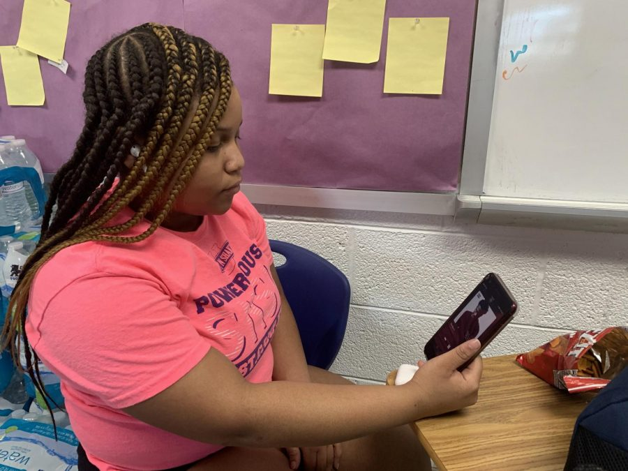 "Listening to Roddy Ricch before cheerleading practice, Freshman Aniyah Tarpley relaxes after school in the cheer classroom. Tarpley said she started streaming his music to calm her nerves before she began a hard workout at practice. ""I actually enjoyed his whole album, and it was better than what I had expected. Out of all the songs, my favorite one is 'The Box' because it's the best,"" Tarpley said."
