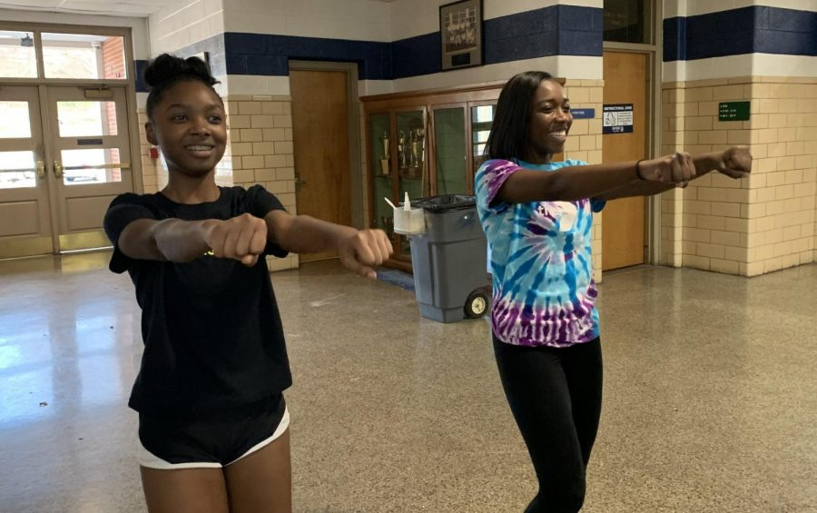 "Going over the routine before practice, Sophomore Anniyah Jackson and Junior Taylor Breedlove refresh themselves on the material while remaining all smiles. Since January, the basketball cheerleaders have had long practices in preparation for their March 21 competition. ""This is going to be my second year competing. I'm very nervous this year because there"